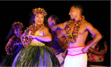 Polynesian dancers dancing at our luau