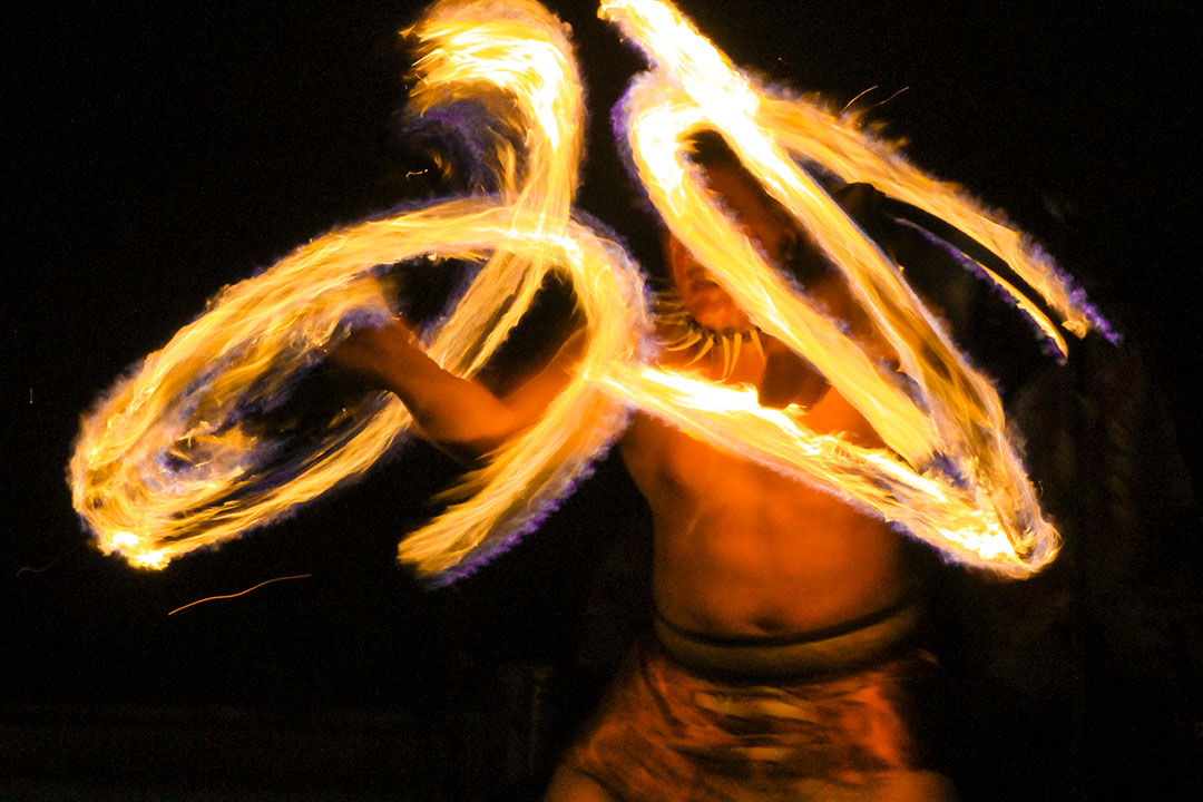 Lu'au dancer swinging fire-knife torches