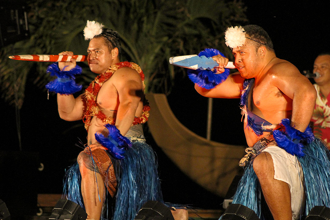 Ceremonial lu'au dancers with spears from Polynesia