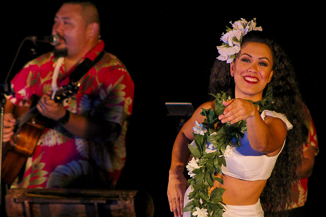Lu'au female hula dancer with musician