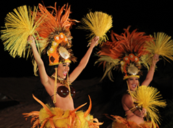 two girls dancing hula representing the islands of tahiti