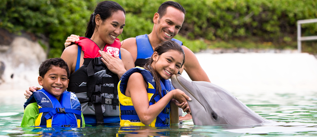 Family with Girl Kissing Dolphin